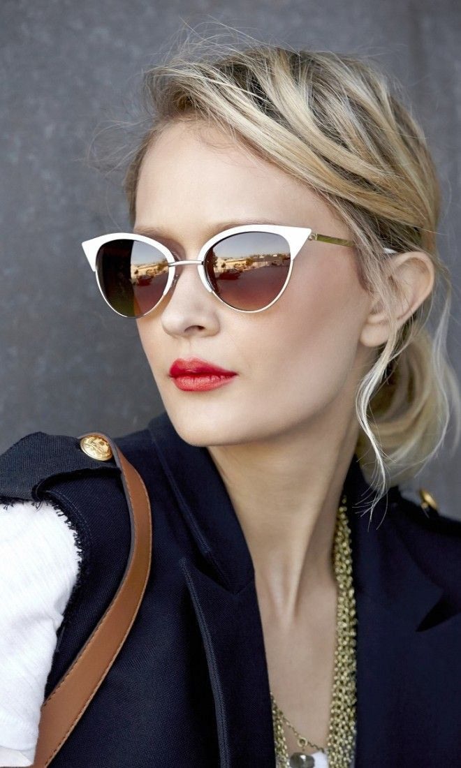 Cat-eye sunglasses with retro-inspired white and gold-toned metal frames