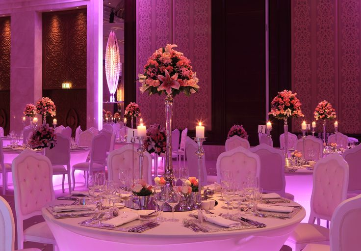A tall floral centerpiece is a perfect choice for a wedding table decoration.