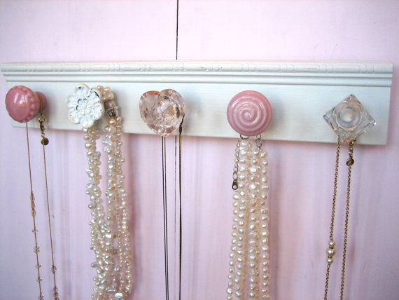 Another adorable necklace rack. I seriously want one of these.  (See the other examples below!).  I love the pink and crystal! $32 from Aunt Dedes Basement on Etsy.