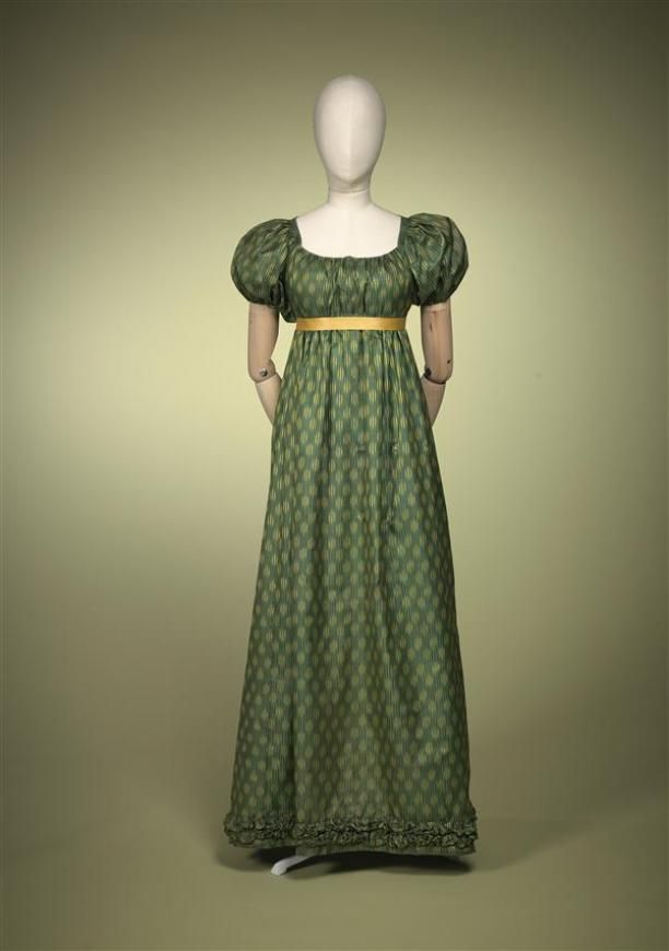 Gown of green silk with woven satin stripes, where yellow chiné effect that suggests balls pattern | Fashion Muse