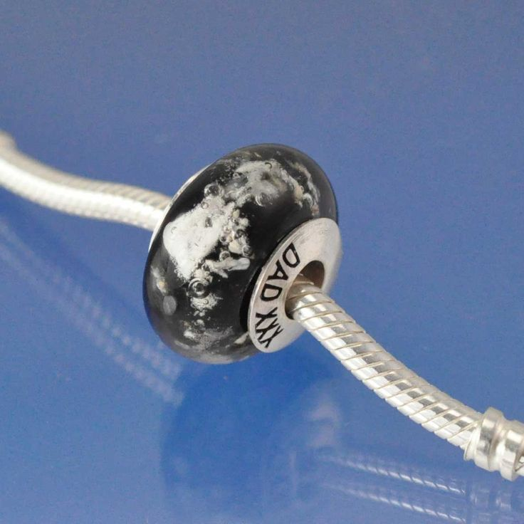 Cremation Ash Bead.  Cremated ashes made into glass beads for Pandora and other bracelet styles. A perfect memorial keepsake.