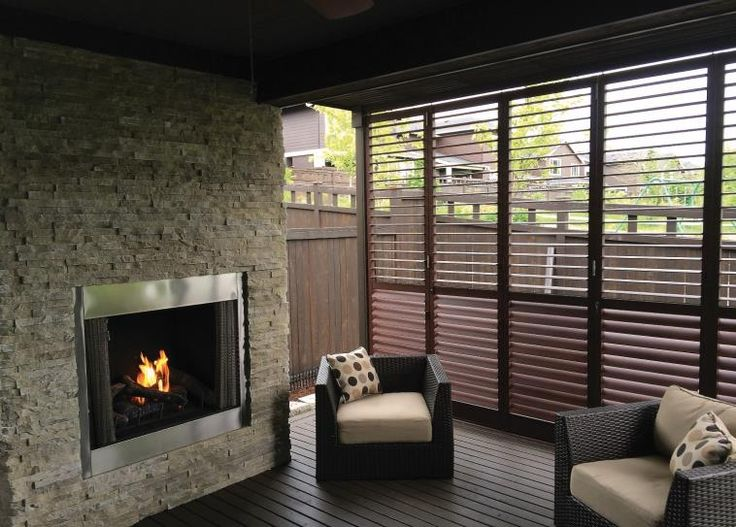 Multi-fold aluminum shutters provide weather protection and privacy for optimum outdoor living. #BudgetBlinds