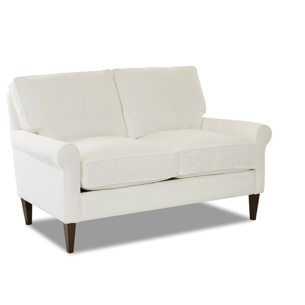 This Loveseat Features A Narrow Rolled Arm A Slight Ear Over The Arm Rail Bordered Back And Seat Cushions And The Op Love Seat Convertible Sofa Soft Seating
