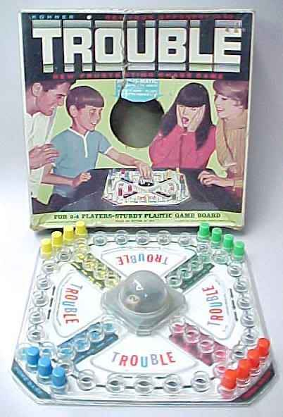Trouble ~ The 'Pop-O-Matic' Board Game! I played this game so many times. It was my favorite, cause my brother couldn't cheat.