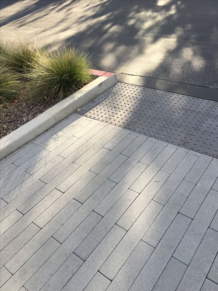 Modern driveway with 2-foot long vertical pavers