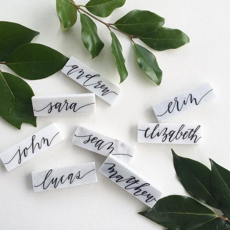 How gorgeous are these marble tiles with calligraphy? So fun for your wedding place cards