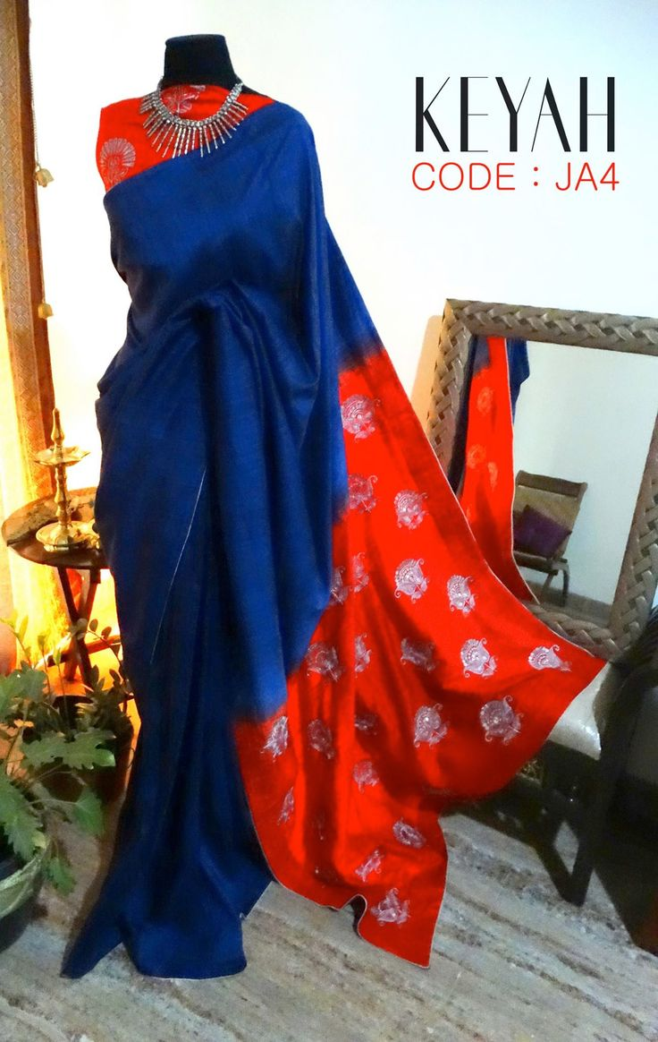 CODE : JA4 A Midnight Blue PURE RAW SILK Saree with expressive hand embroidered silver threaded floral motifs on the pallu. It s paired with printed red raw silk blouse piece.We this is an absolute steal! shoponline .