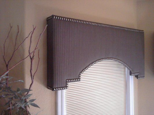 Shaped cornice box with head-to-head tacks. Made by Nouveau Designs.