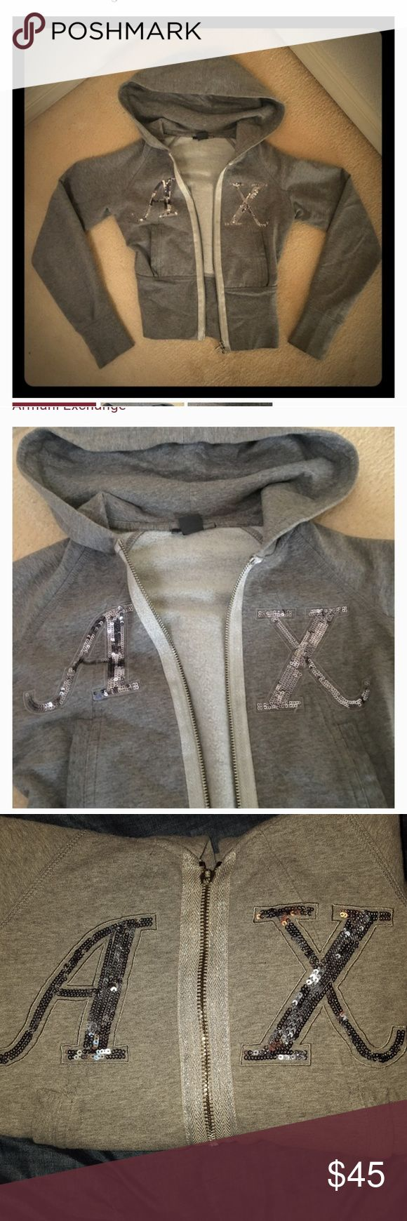 Armani Exchange Sequin Fleece Hoodie XS Armani Exchange grey fleece zip up hoodie. With sequin AX on chest. Very comfortable. Matches great with grey or black leggings. Zipper works perfect, missing zipper hook to pull it up and down shown in the 6th picture above. Easy repair. Armani Exchange Jackets & Coats