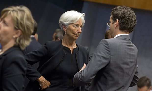 Managing Director of the International Monetary Fund Christine Lagarde, left, speaks with Dutch Finance Minister and chair of the eurogroup Jeroen Dijsselbloem at the start of a round table meeting of eurogroup finance ministers at the European Council building in Luxembourg on Thursday, June 18, 2015. German Chancellor Angela Merkel is pressing Greece to deliver on commitments to carry out reforms, stressing that she wants the country to remain in the common currency. (AP Photo/Virginia…