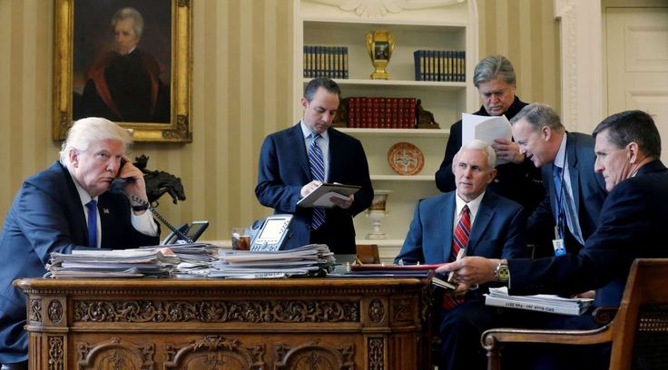 Trump's first 100 days:    President Trump ﴾L‐R﴿, joined by Chief of Staff Reince Priebus, Vice President Mike Pence, senior advisor Steve Bannon, Communications  Director Sean Spicer and then National Security Advisor Michael Flynn, speaks by phone with Russia's President Vladimir Putin in the Oval  Office.