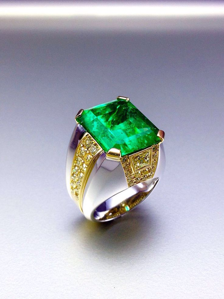 Stunning Columbian Emerald men's ring accentuated by fancy vivid yellow diamonds in two tone gold setting