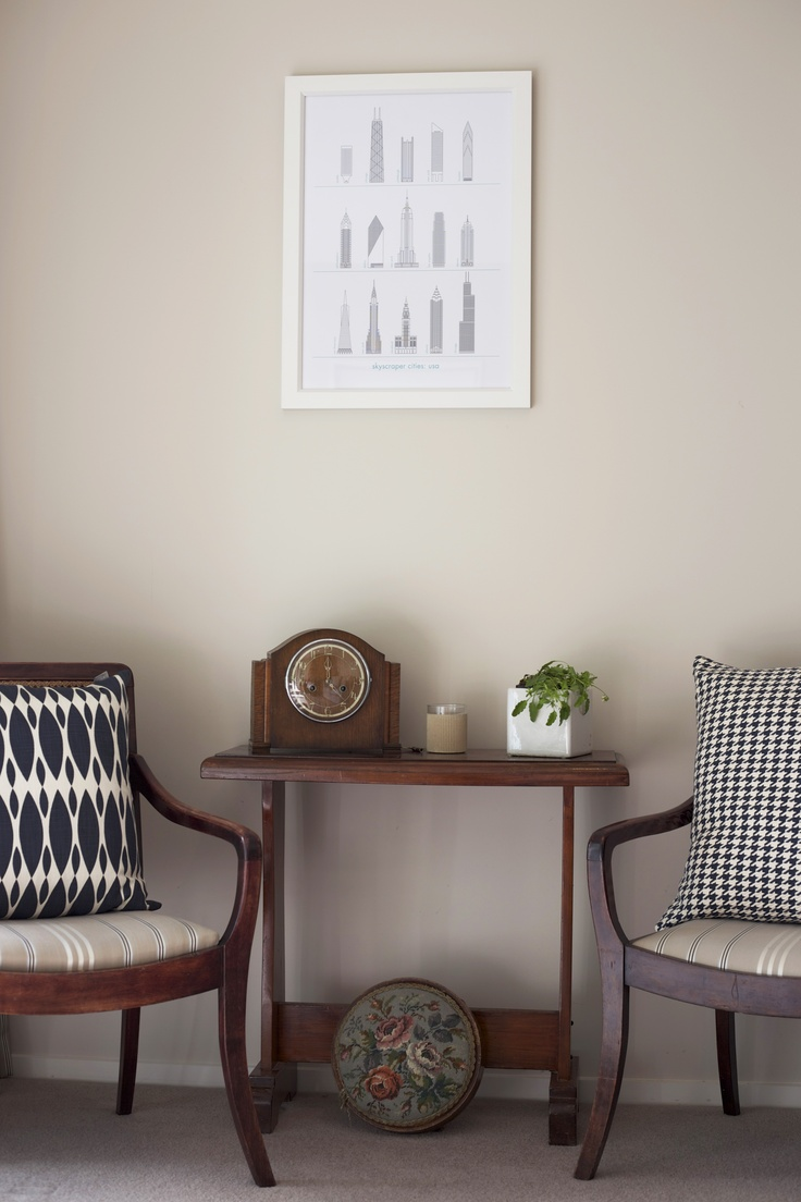 Modernise, create focus and lighten dark wood furniture. Architecture print #endemicworld. cushions #citta. potted greens.
