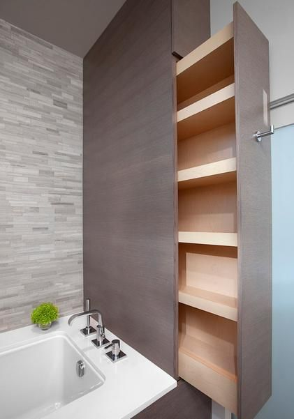 If youre planning to have your bath run the width of your room, you may have noticed that you have enough space left over to make a bath storage cabinet.