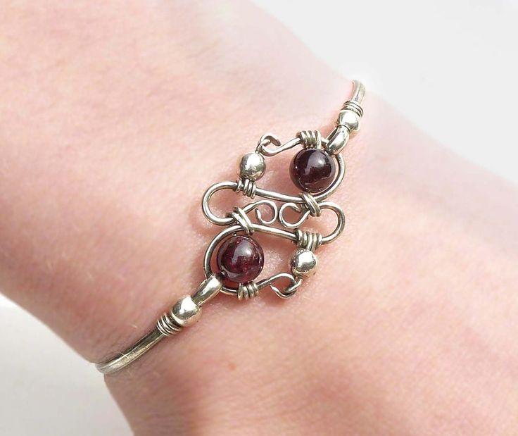 Wire wrap silver bangle, dark red garnet bangle, sterling silver and garnet bracelet.  via Etsy.