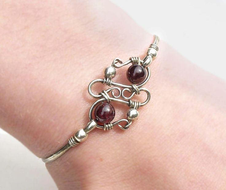 Wire wrap silver bangle, dark red garnet bangle, sterling silver and garnet bracelet.