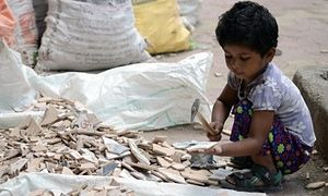 An Indian child breaks tiles in Mumbai, June 2015. India's government recently toughened child labour laws, but activists say the steps are inadequate.