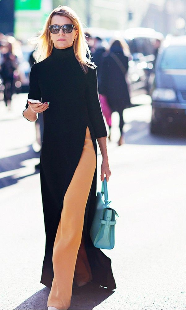 Turtle neck maxi dress with high-slit worn over camel colored trouser pants