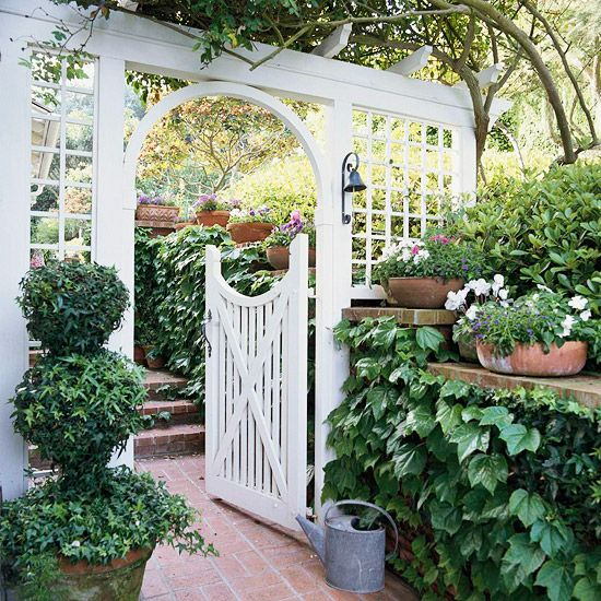 """flip it - another thought is putting the """"shelf"""" on the front porch side (behind the swing) with trailing plants in front of the porch, hostas below, gate in front of cans and air conditioner thingie, and the lattice fence blocking off the neighbor's yard"""