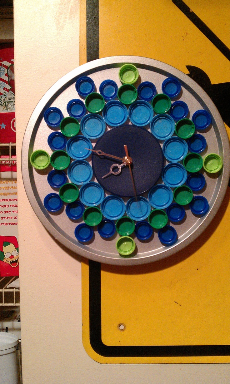 Homemade wall clock...round cookie sheet, upside down plastic bottle caps!  Clever.