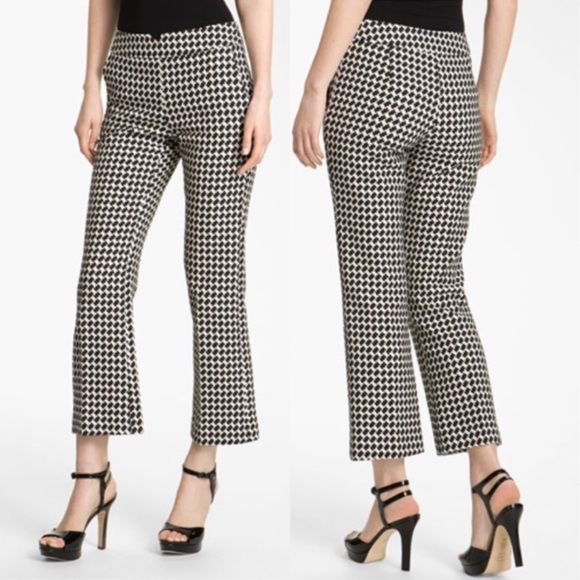 """  Trina Turk   Fez Houndstooth Crop Pant A pixelated houndstooth pattern and abbreviated hems usher a classic style into contemporary vogue. A front-notched waistline and streamlined, hidden side zip further update the figure-flattering look. Front slant pockets. Approx. inseam: 27 1/2"""". Approx. rise: front 9""""; back 15"""". Partially lined. Cotton; dry clean. By Trina Turk; made in the USA. Individualist. Trina Turk Pants Trousers"""