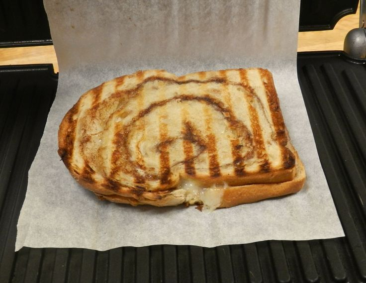 Surround your sandwich with parchment before putting into your panini grill. Yes, the grill marks happen right through the paper. Cleanup is done before you begin!