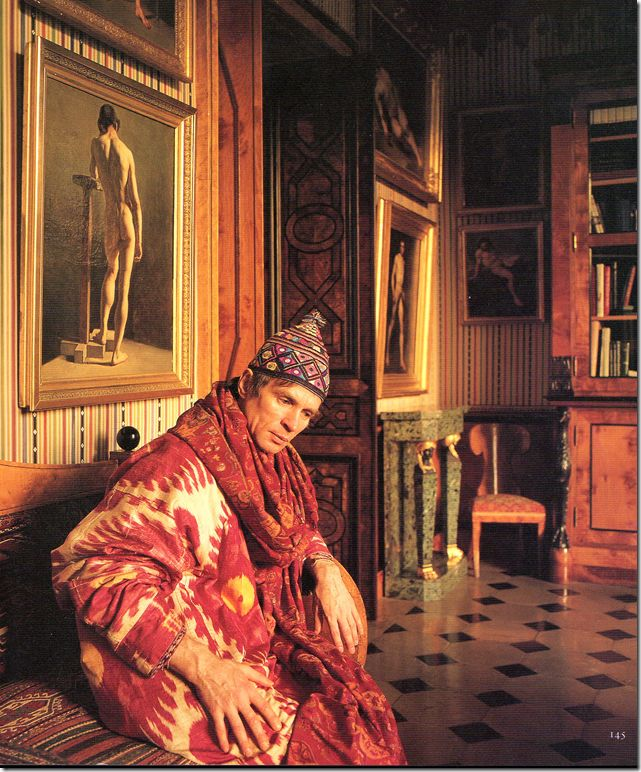 Rudolf Nureyev in his Paris Apartment, wearing a silk ikat. Emilio Carcano helped Nureyev decorate the apartment, which was photographed by Derry Moore for Architectural Digest in 1985