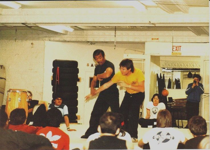 Assiting Sifu Dan inosanto during seminar at Degerberg Academy