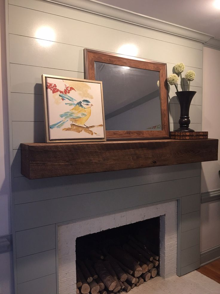 This fireplace transformation started with covering the Wood paneling transformation