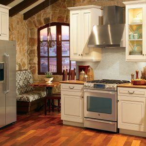 Cream Colored Kitchen Cabinets With Stainless Steel Appliances