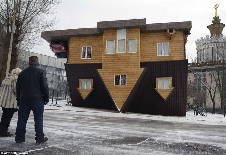 At first glance, it looks like the occupants in this home are stuck to the ceiling.   But amazingly the house was built this way as a tourist attraction at the VVTs the All-Russia Exhibition Center in Moscow.   As well as its impressive exterior the house is fully furnished with decor, belongings and even a Mini - all painstakingly installed upside down.