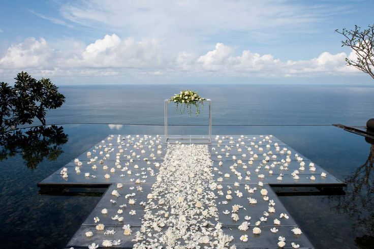 Water Wedding at Bvlgari Hotel Bali. The altar is set upon a transparent carpet gently floating on the surface of the Water Pond. A truly unique experience, for a wedding ceremony held in front of the infinity of the Indian Ocean.