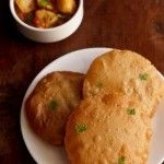 rice pooris recipe with step by step photos. these rice pooris also known as tandalache vade are easy to prepare and are made with rice flour.