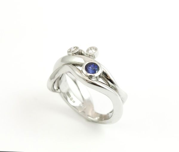 18ct white gold wave-style engagement ring with blue sapphire and diamonds. Engagement rings Cork city.