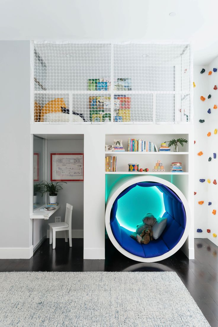 The twins' nursery isn't the ordinary nursery to expect. This playful space is complete with a jungle gym, rock wall, and a light tunnel.