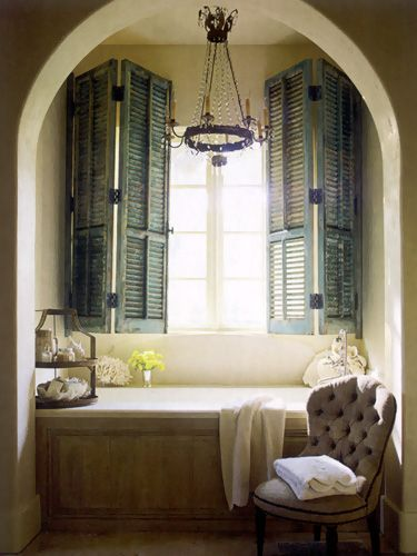 Shutters in the bathroom - love this...and the chandelier.