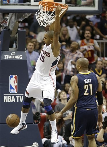 Al Horford dunks the ball agains Indiana Pacers power forward David West during the first half in Game 3 of their first-round NBA basketball playoff