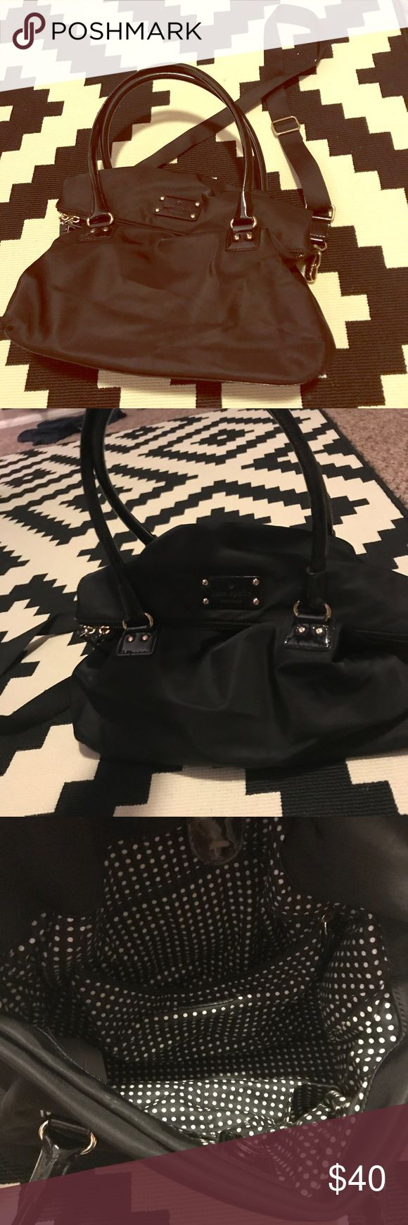 Kate Spade black nylon shoulder bag Kate Spade black nylon shoulder bag. Front flap with functional pocket. Polka dot fabric interior and printed logo bottom. Removable long strap is great for carrying this as a crossbody tote! kate spade Bags