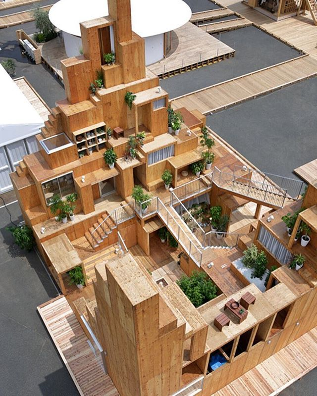 sou fujimoto has constructed the 'rental space tower' pavilion for 'house vision 2 tokyo', an exhibition which focuses on domesticity. the timber structure is based on the concept of sharing, and features an interconnected system of pathways, common areas and plant-filled terraces. photo by daito trust  see more about the project on #designboom #architecture #housevision2016tokyo #soufujimoto @sou_fujimoto @housevision2