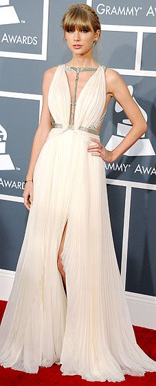 Taylor Swift walked the red carpet at the 2013 Grammys wearing a J. Mendel gown and Jimmy Choo shoes.
