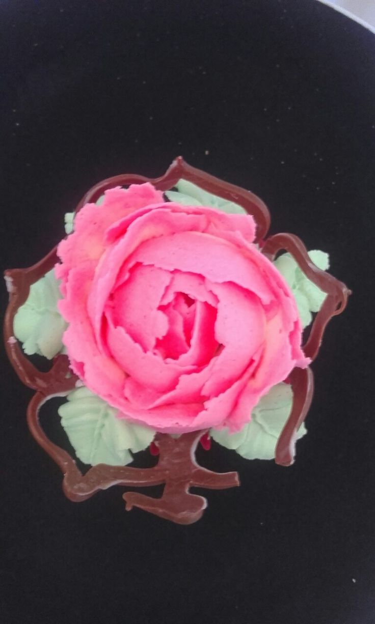 Top view rose in a flower pod cupcake