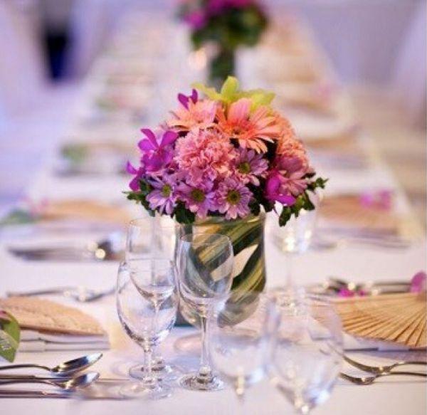 Purple and Peach Flower Centerpiece Decor on @southasianbride via @aislesociety