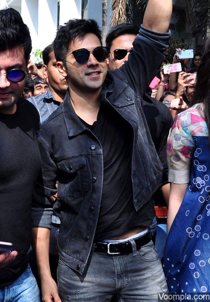 Varun Dhawan rocks a black denim jacket over a matchin T-shirt, jeans and black sunglasses. via Voompla.com