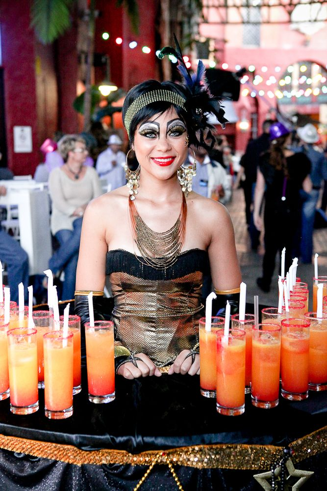 """Step right up!"" and enjoy an icy cold welcome drink from our Carnival queen. #carnival #eventplanning"