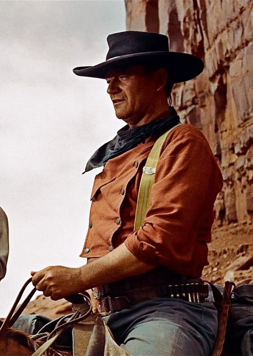 John Wayne in The Searchers (dir. John Ford)  This is such an amazing movie on so many levels. It is worth watching again and again.