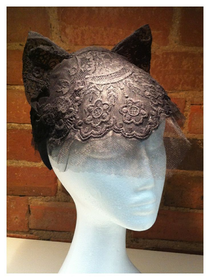 Cats ears. 3 layers of toile blocked and (painted on) stiffened with pva 50/50 on head form.  Lace formed and stitched soaked in pva mix and shaped on head form.  Pieces assembled, wired edge and ears. Mounted on fabric headband. Pinking scissors on each layer of toile.