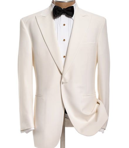 While peaked lapels on white jackets are perfectly acceptable, the more casual effect of the shawl collar is ideally suited to this less formal dinner jacket.