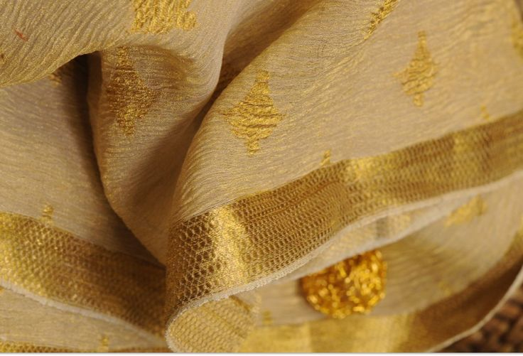 Dwell in the mystique beauty of this royal Silk tissue Jacquard fabric and be a 'modern maharani' this festive season.