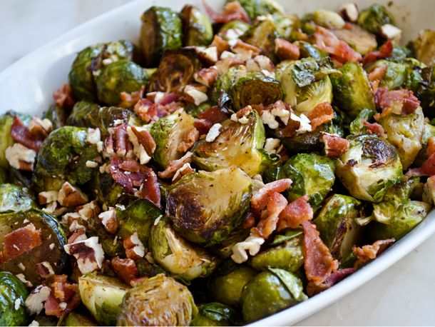 Roasted Brussels Sprouts tossed in Maple-Balsamic Vinaigrette, topped with bacon and toasted pecans.  Make sure the Brussels Sprouts are browned well, and crispier bacon works better.