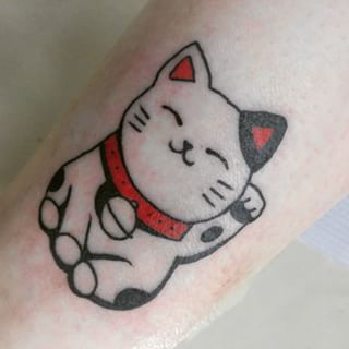 This adorable Lucky Cat. | 27 Classy Cat Tattoos Every Cat-Lover Will Adore